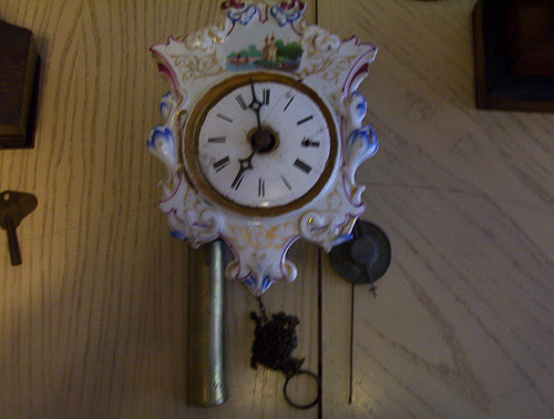 Thread black forest porcelain wall clock and photo